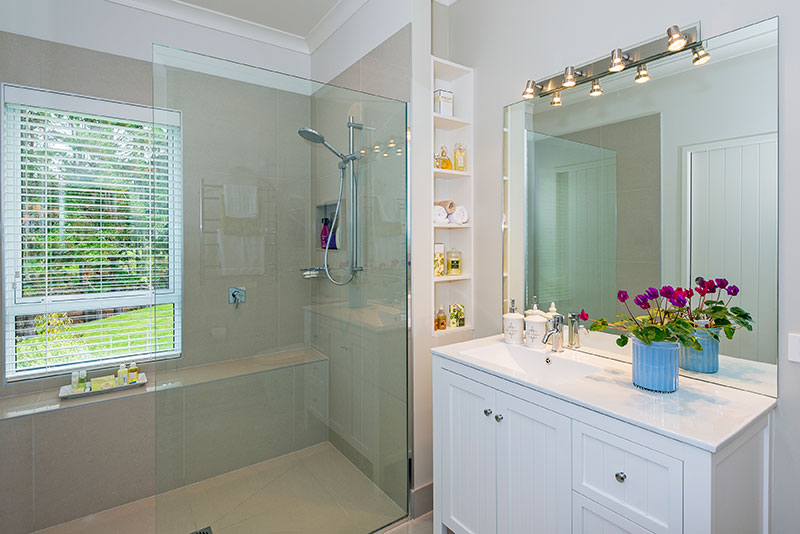 Traditional and modern style bathroom in colonial style award winning home built by Precision Homes