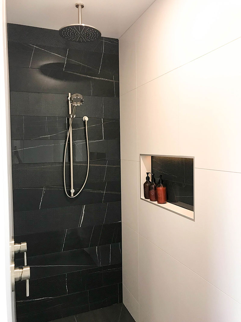 Tile Space Black Marble tiles at back of tiled walk in shower with recess box