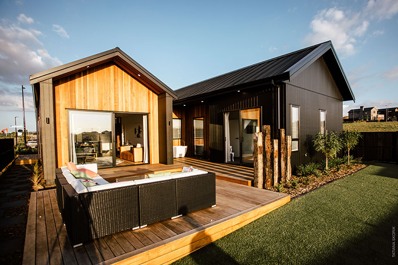back deck of beauitful bespoke home clad in cedar and black axon panel