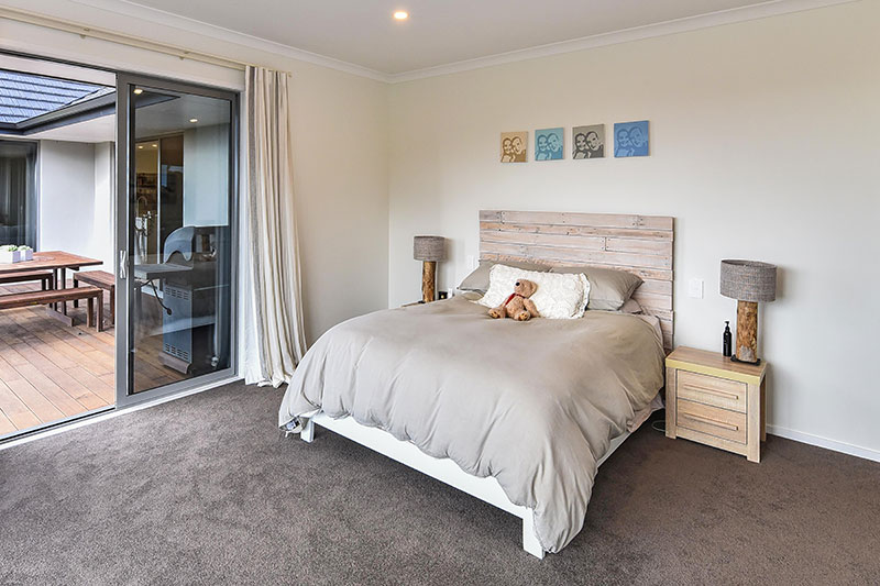 large scandinavian style master bedroom with rustic whitewashed pallet headboard