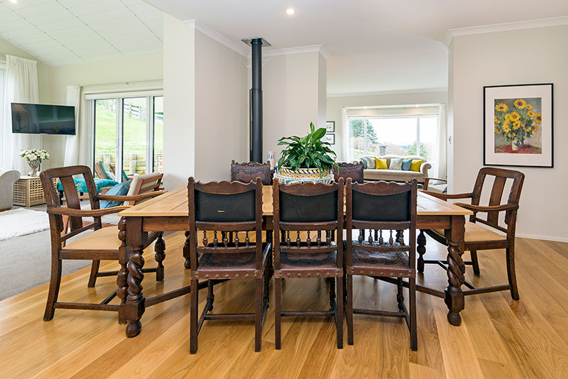 Dining area with lovely bespoke furniture in colonial style award winning home
