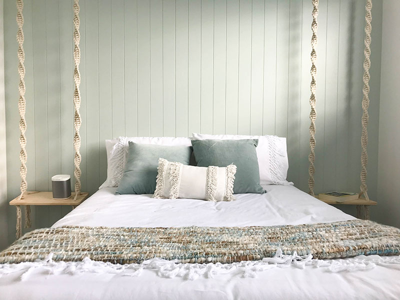 Bedroom with mint duckegg feature wall with hardigroove. Rope swing side tables