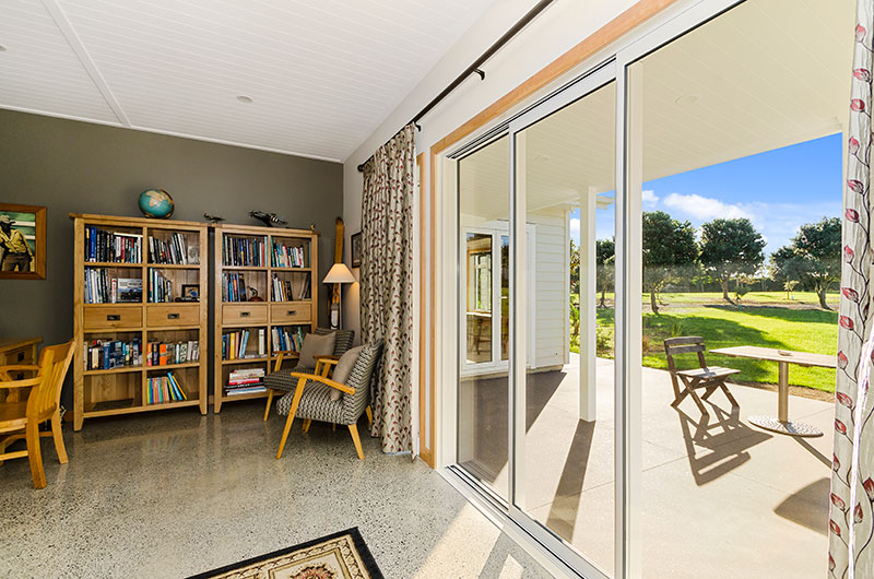 Study nook with polished concrete floor and outdoor area at Award winning colonial home in Waiau Pa