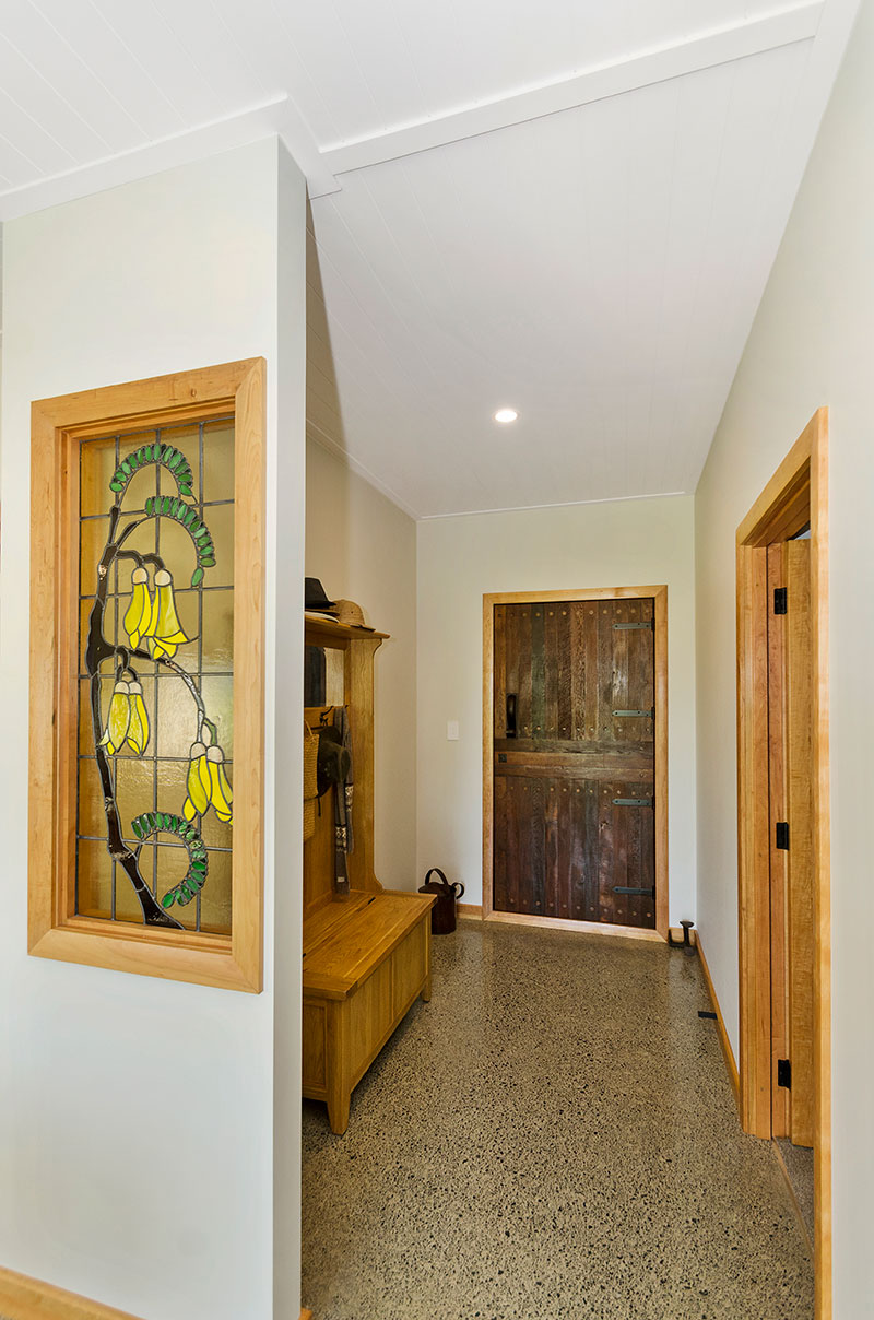 Stunning kowhai stained glass panel and chilean wood rustic entry door in award winning home