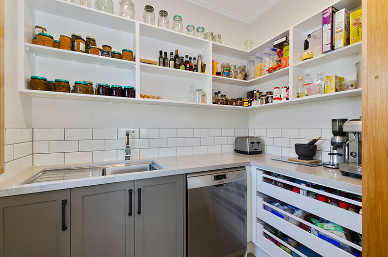 Large butlers pantry in colonial style kitchen in award winning home. Expansive storage, large sink & white subway splash back
