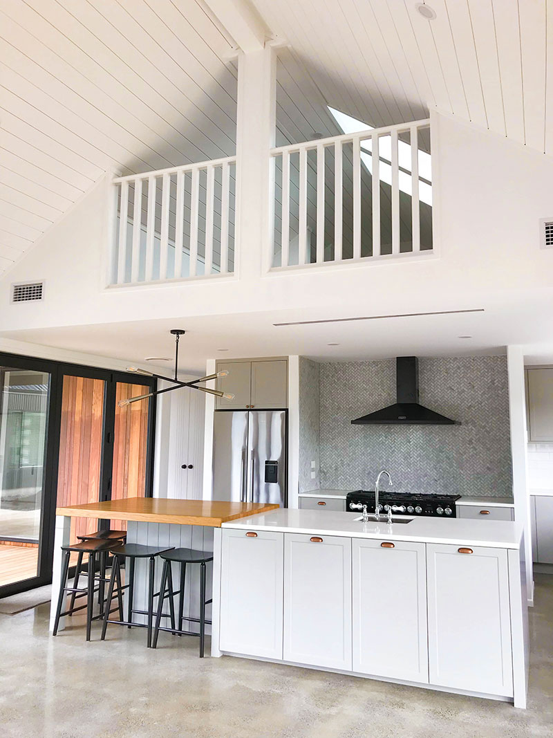 Modern and traditional style kitchen in new barn style home with hidden upstairs nook for kids playroom